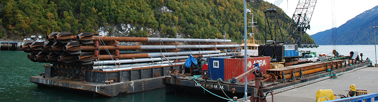 SPIN FIN Piles on Barge In Skagway_Banner
