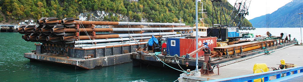 SPIN FIN Piles on Barge In Skagway